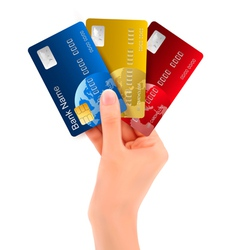 Male hand showing credit cards vector image