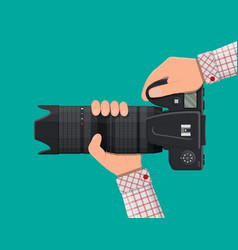 modern photo camera in hand vector image