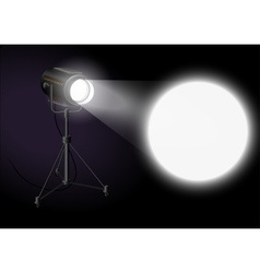 Spotlight shines bright spot on the wall vector image