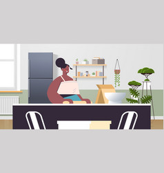 african american woman preparing food at home vector image