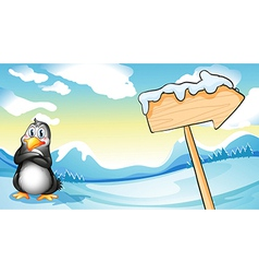 A penguin beside the empty arrowboard vector