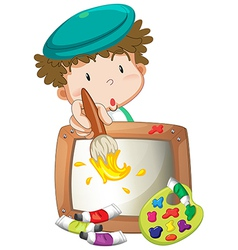 A little boy painting vector image
