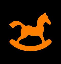 Horse toy sign orange icon on black background vector