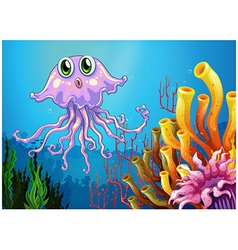 A cute jellyfish near the coral reefs vector image