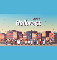 Kids wearing monsters costumes walking town vector