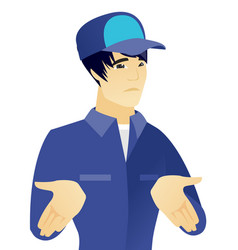Young asian confused mechanic shrugging shoulders vector