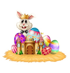 A king bunny with easter eggs vector image vector image