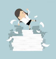 Businesswoman falling off paper mountain vector