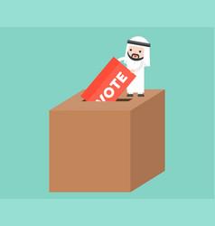 Tiny arab man dropping ballot into big box vote vector