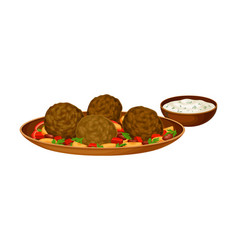 Meatballs with vegetables served with sour cream vector