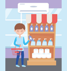 Young with basket buying cleaning products in vector