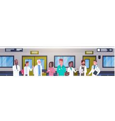 group of doctors in hospital corridor horizontal vector image