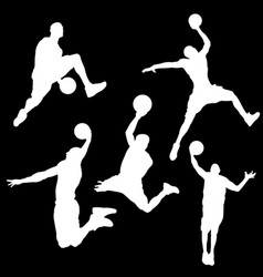 White silhouettes of a basketball player on a vector