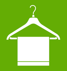 Hanger with cloth icon green vector