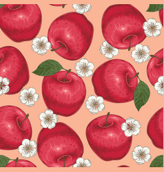 Seamless pattern with red apples and flowers vector
