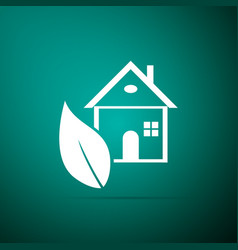 eco house icon isolated on green background vector image