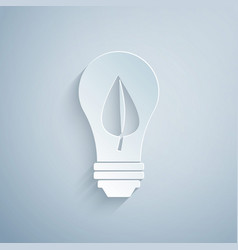 Paper cut light bulb with leaf icon isolated on vector