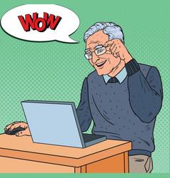 Pop art happy senior man working with laptop vector