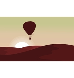 Silhouette of desert with air balloon in the sky vector
