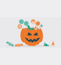 A jack-o-lantern filled with treats vector