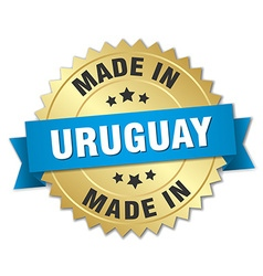 Made in Uruguay gold badge with blue ribbon vector
