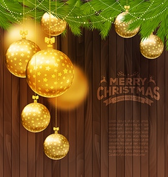 Christmas balls on wooden background vector image