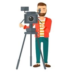Cameraman with movie camera vector