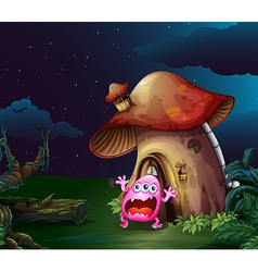 A scared monster near the mushroom house vector image vector image