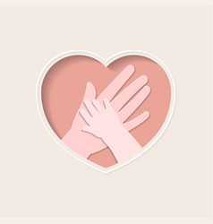 hands of mother and baby in heart shaped paper art vector image