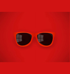 red sunglasses on red background vector image