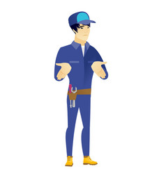 asian confused mechanic shrugging shoulders vector image