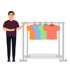 The guy shows off a wardrobe of t-shirts a man vector
