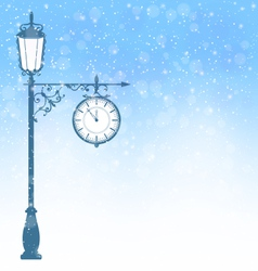 Vintage lamppost with clock in snowfall on blue vector image