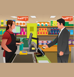 Man paying at the cashier using phone vector