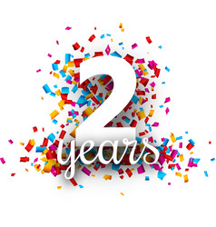 Two years anniversary with colorful confetti vector