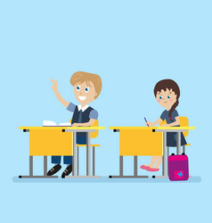 schoolchild sits at a school desk during lessons vector image