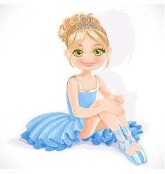 Beautiful little ballerina girl in blue dress sit vector image vector image