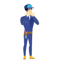 shoked asian mechanic covering his mouth vector image
