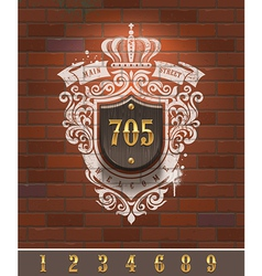 Vintage home number sign on brick wall vector