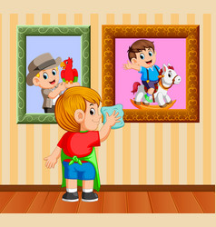 Boy clean up the frame photo with the towel vector