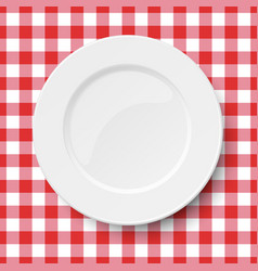 Empty white plate placed on a kitchen table cloth vector
