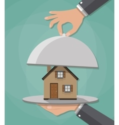 Hand opens serve cloche with house inside present vector