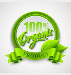 Organic emblem with ribbon and green leaves vector image