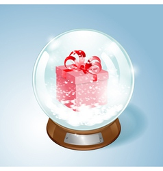 Snow globe with the gift and the falling snow vector