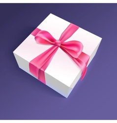 White gift box with red ribbon and bow vector