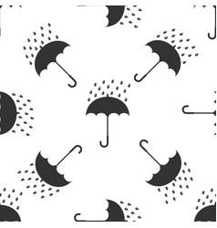 umbrella and rain drops icon seamless pattern vector image