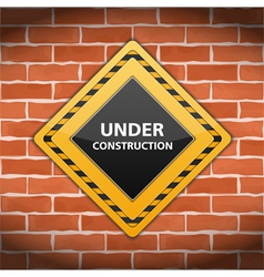 Under Construction Sign on Brick Wall vector image
