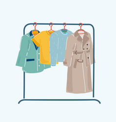 Clothes or apparel hanging on hangers on rack vector