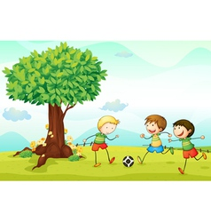 Kids playing football vector