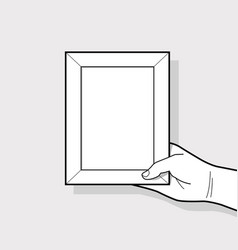 hand holding picture frame vector image